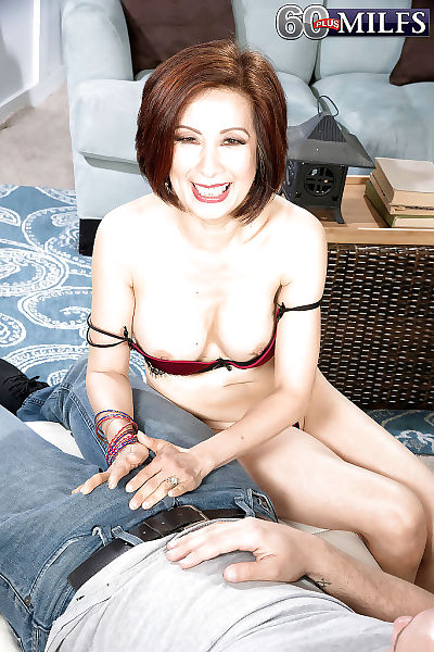 Busty Asian granny Kim Anh..