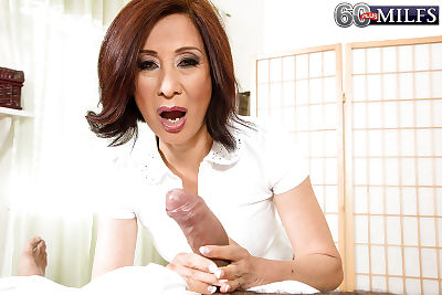 Asian gran Kim Anh giving..