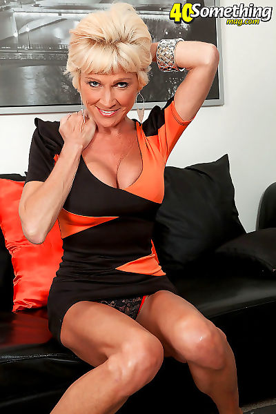 Niki mature with blonde hair..