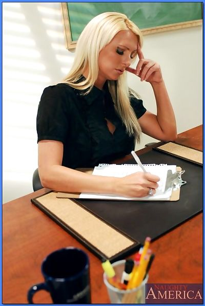 Blond teacher with ripe..
